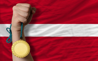 Gold medal for sport and  national flag of latvia