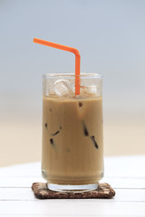 Iced coffee with straw in glass