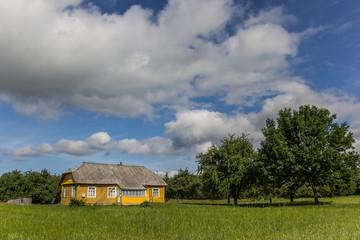 Yellow wooden house in Aukstaitija National Park