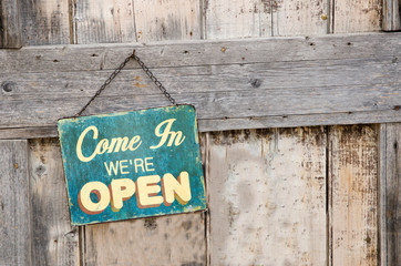Vintage open sign on old wooden door