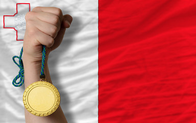 Gold medal for sport and  national flag of malta