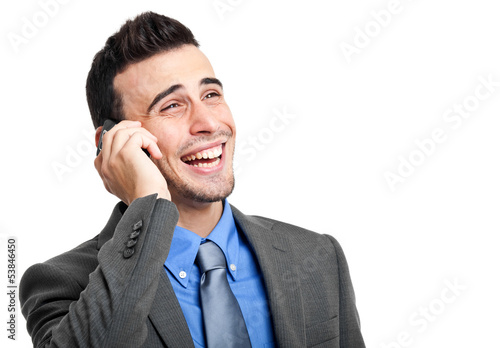Smiling businessman talking at the phone isolated on white