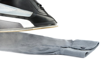Steam iron on a gray shirt
