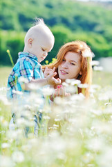 mother and son in field