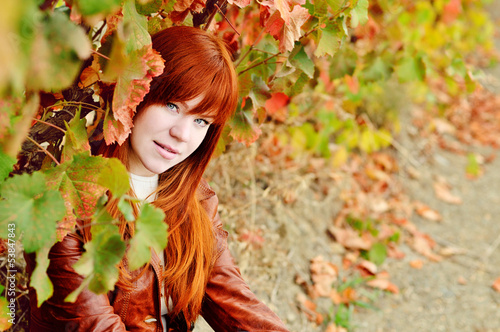 redhead girl in fall time