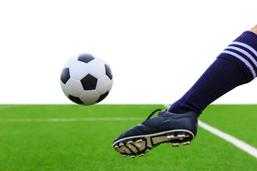 foot kicking soccer ball isolated