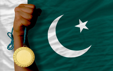Gold medal for sport and  national flag of pakistan