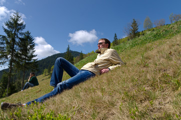 Man relaxing on a steep slope