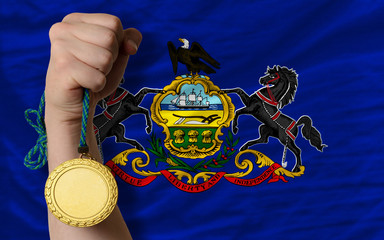 Gold medal for sport and  flag of american state of pennsylvania