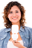 Woman with an energy saving bulb