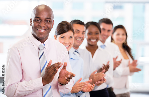 Successful business team applauding