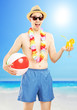 Smiling male in swimming shorts, holding a beach ball and cockta