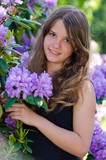 Teenager with rhododendron