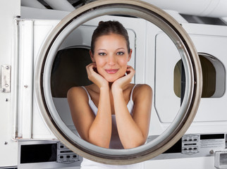 Woman Leaning On Washing Machine Door