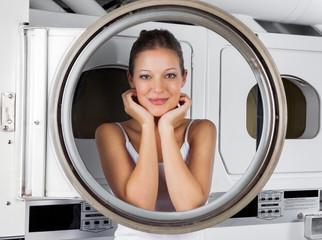 Woman Leaning On Washing Machine Door