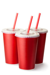 Three red cardboard cups with a straws