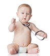 Sweet baby with stethoscope on a white background. Adorable baby