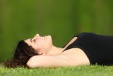 Attractive woman relaxed lying on the grass in a park