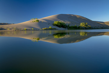 Sand dune on the edge of a small lake