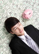 happy businessman look pink piggy bank
