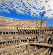 Beautiful plumose clouds over the ancient Colosseum. Rome. Italy