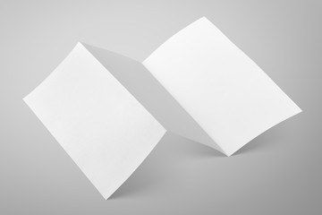 Empty fold flyer on gray with clipping path
