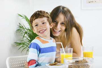 Mother and son having breakfast.