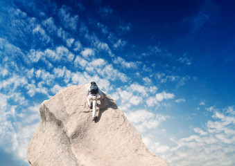 Young man climbing on a limestone wall
