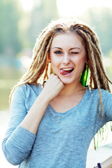woman with dreads making face