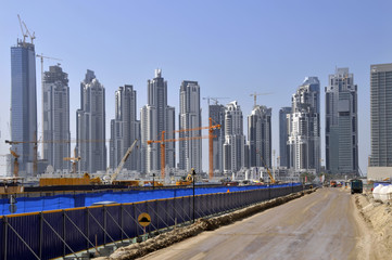Dubai construction site with high rise skyscrapers