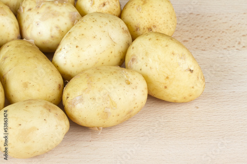 Jersey Royal new potatoes on a wooden chopping board