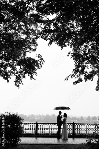 loving couple under an umbrella