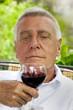 Happy senior enjoying drink