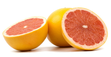 Cut grapefruit isolated on white background