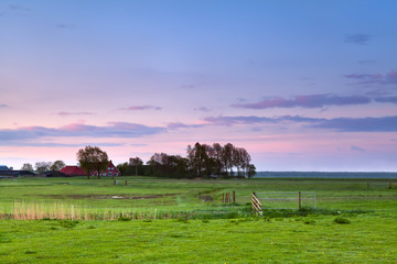 little farmhouse at pink sunrise