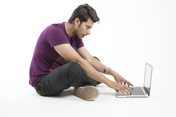 Shocked man expression with laptop