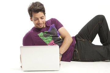 young male relaxed working on laptop