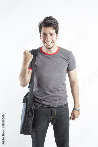 Young student carrying bag