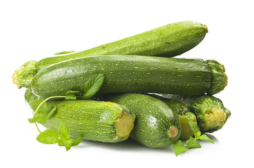 Fresh zucchini close up on the white