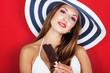Happy sexy woman holding ice cream