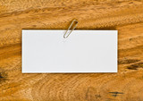 White paper on wooden background,For text
