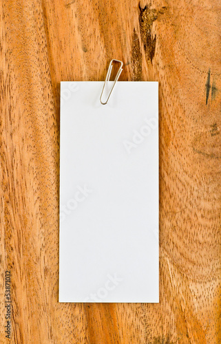 White paper on wooden background