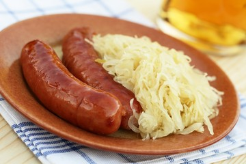 Plate with sausages and pickled cabbage