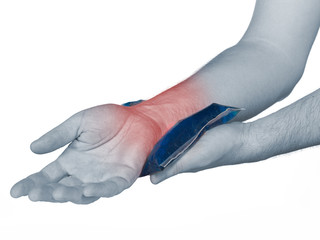Wrist pain. Male holding ice pack on wrist.