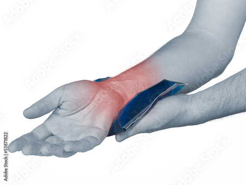 Wrist pain. Male holding ice pack on wrist.
