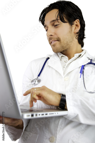 Happy male doctor working with laptop