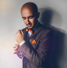 Square photo of elegance male in orange bowtie
