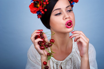 Artistic portrait of cherries in the mouth