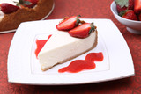 Cheesecake with strawberries and sauce