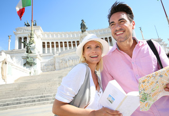 Couple reading map by the monument of Victor Emmanuel II